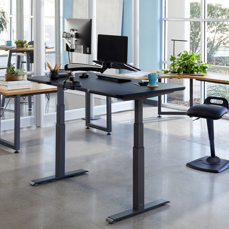 Electric Standing Desk 60x30 Black in raised position at office image number null